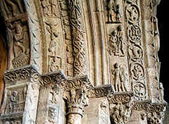 Ripoll in the southeastern part of the Pyrenees. Here the old portal with the many statues and figurs.